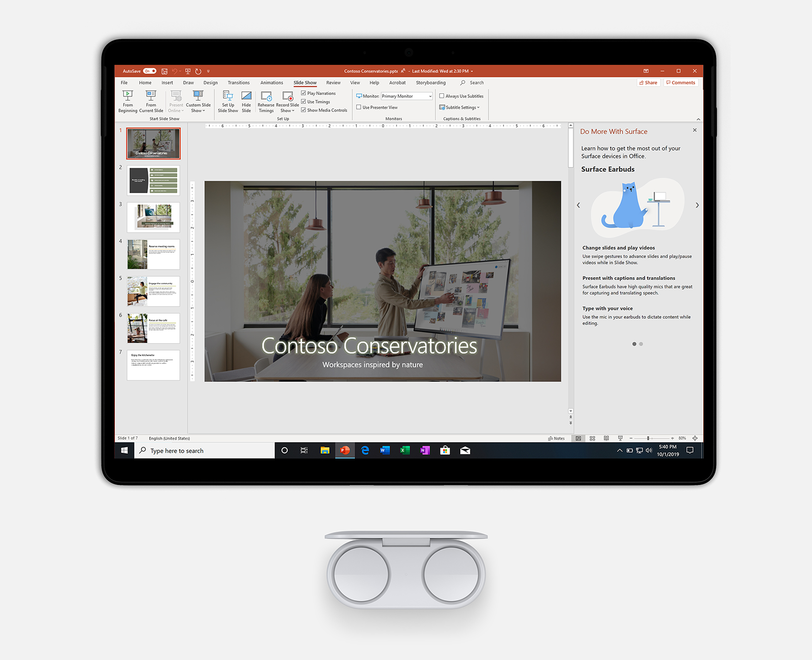Image of Earbuds and the Surface Pro 7 displaying PowerPoint.